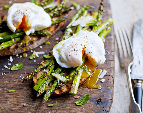 Grilled asparagus and poached egg Photographer: Tara Fisher