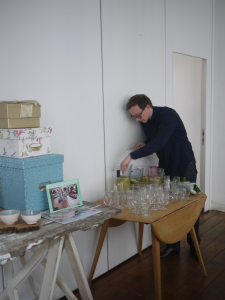Pete setting up the drink station for our arrival cocktail: gin, limoncello, elderflower, apple and mint