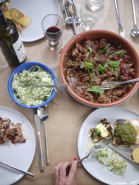 Slow cooked rolled shoulder of lamb with dates and pomegranates. Cypriot style cabbage slaw.